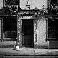 cleaning - The Peveril of the Peak is a well known public house in the city. Clad in Victorian tiles, it stands as a reminder of days gone by. -  print for sale