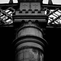 ironwork - This photograph was taken at Castlefield. This iron structure supports the trams as they work their way in and out of the city. Once upon a time, trains would have used this route to arrive at Manchester Central Station. This is no longer a train station today. Modern Mancunians will know it as the GMEX. -  print for sale
