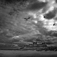 bamburgh - Bamburgh castle stands almost on the shore and is one of Northumberland's most iconic structures. -  print for sale