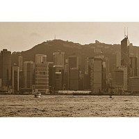 acrossthewater - View of Central from Kowloon. This photograph was taken in 2005. In the foreground, a small junk can be seen with the tall high rise buildings of Hong Kong's Victoria Island in the background.