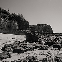 algarvebeach - Rocks and stones across a beach on the Algarve