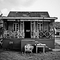 islandcraft - Shop at Bathsheba. Look closely at the photograph and you can see the shop keeper taking an afternoon siesta.  -  print for sale