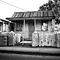 moorsville - Chattel House. Many of the houses in Barbados are Chattel Houses. The idea behind one of these houses is that they can be moved when necessary.  -  print for sale