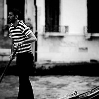 gondolieronwater - A gondolier in Venice, Italy.  -  print for sale