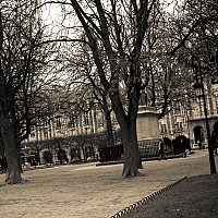 inthecourtyard - Courtyard shot of the Place Des Vosges. This famous square is popular with romantic couples. -  print for sale