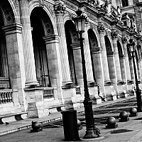 lamposts - Detail of La Musee Du Louvre. This world famous Museum sits at one end of the Champs Elysees and houses some of the most important artworks in the world.  -  print for sale