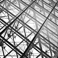 lattice - Commissioned in 1984, the Pyramid at the Louvre is an I M Pei's design of steel and glass that covers the entrance to the museum. Many would argue that this design is a triumph of the successful combination of old and new architecture. -  print for sale