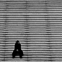 musing - On the steps of La Defense. La Defense was a controversial design when first opened. The design was deliberately offset to contrast Baron Haussman's neat and ordered boulevards. -  print for sale