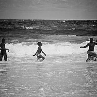chaseme - Children in the surf. Local Bajan children playing in the surf at Carlisle Bay. -  print for sale