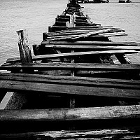 jetty - A dilapidated old Jetty at Needham Point. This jetty looks out across the Caribbean sea towards Bridgetown. -  print for sale