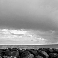 skyandrocks -  This photograph shows rocks on the beach at Needham Point. Needham point lies just outside the capital.  -  print for sale