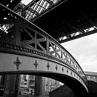 castlefieldbridges - You don't have to wander to far in Manchester to see the heavy industry that once reigned supreme. At Castlefield, much of this has gone but the city has incorporated the old with the new and the area is now thriving with bars and apartments.