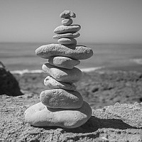 clever - Stacked rocks on the beach