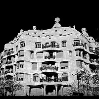 gaudihouse2 - Barcelona, 2003. In Barcelona, the influence of Antoni Gaudi is everywhere. This photograph shows a Gaudi designed facade on the Ramblas.  -  photograph for sale