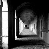 monastery - This architectural photo shows off the archways of the Royal Palace at Aranjuez. A summer home for the King of Spain.  -  photograph for sale