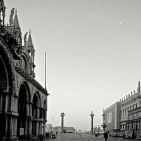 outtothewater2 - From St Marks square looking out, early morning,  Venice, Italy. At 5 in the morning, there were still people about. This photograph shows the Doge's Palace and the bottom of the Campanile.  -  photograph for sale