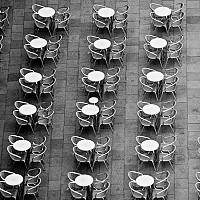 tables - Tables on St Marks, Venice, Italy. From high above Venice, the tables in St Mark's Square are laid out in neat rows. This photograph was taken in 2008. -  photograph for sale