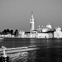 veniceatnight - At night, Venice, Italy. This photograph was taken looking across from St. Mark's Square. The slow shutter speeed creates the peculiar lighting effect.  -  photograph for sale