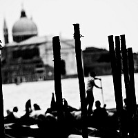 venicewaterways - Canals of Venice, Italy. This abstract photograph captures the dynamicism of the gondoliers and the waterfront in front of St Mark' Square, Venice. This picture was taken in 2008. -  photograph for sale