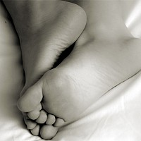restingfeet - A black and white photograph taken in 2004. This photograph has a hint of sepia added in post processing.