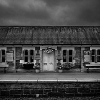 settlestation - At Settle Train Station, North Yorkshire. This black and white photograph captures the charming station and platform at Settle, North Yorkshire.