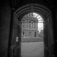 thecamera - View of the Camera, Bodleian Library, Oxford. The Radcliffe Camera is one of Oxford's most famous landmarks. This black and white photograph shows the Camera through a gateway.